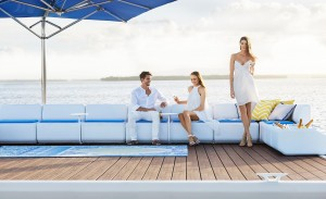 Waterscape by Superior image of 2 girls and man enjoying drinks on pontoon